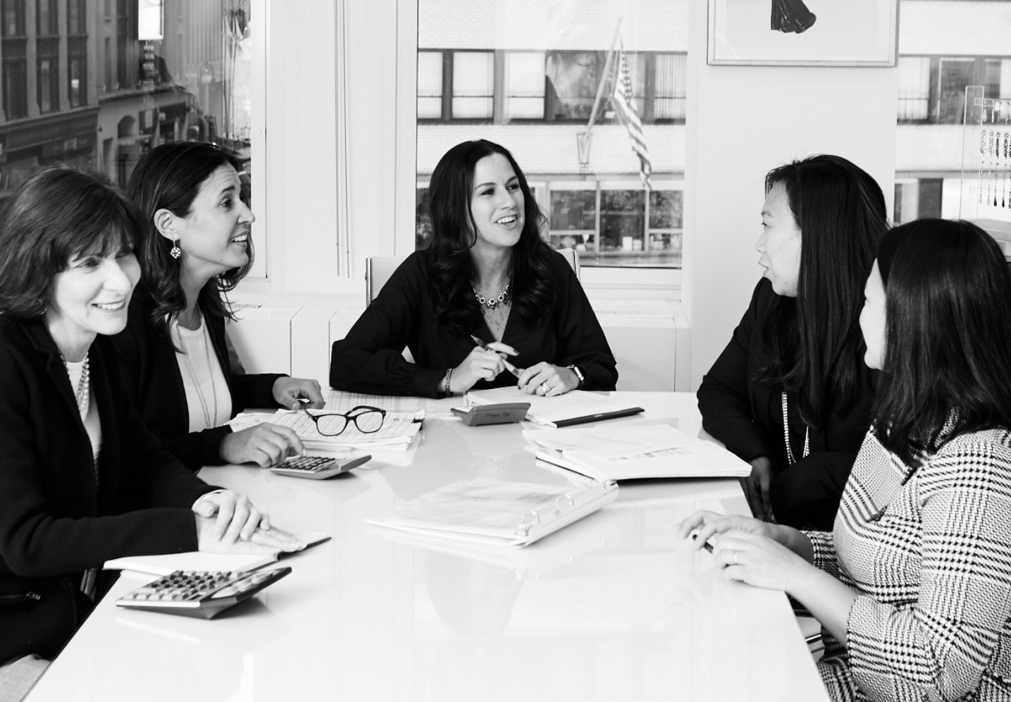 Group of colleagues from The Jewelry Group having a business meeting in the jewelry showroom