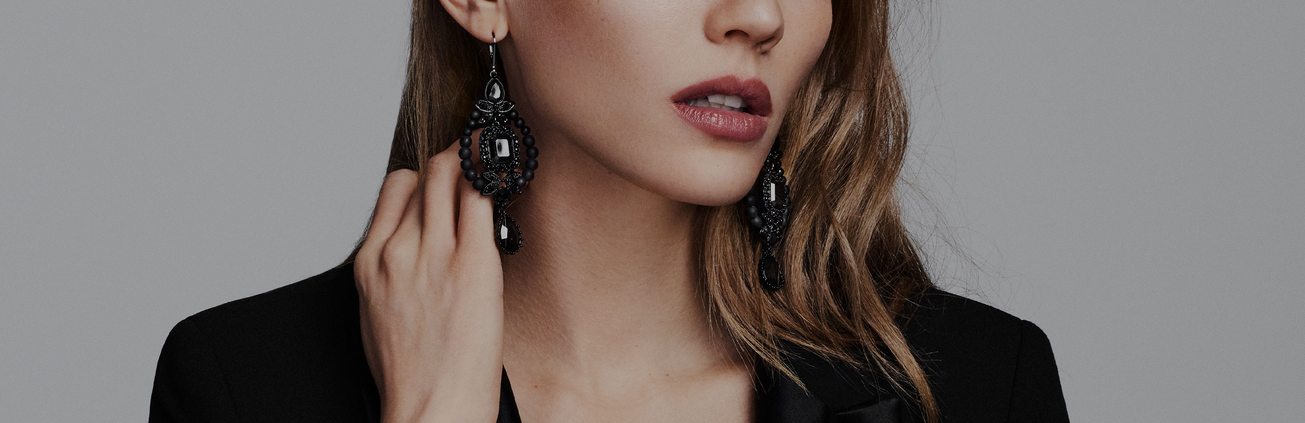 Close up photo of woman wearing Jewelry produced by The Jewelry Group
